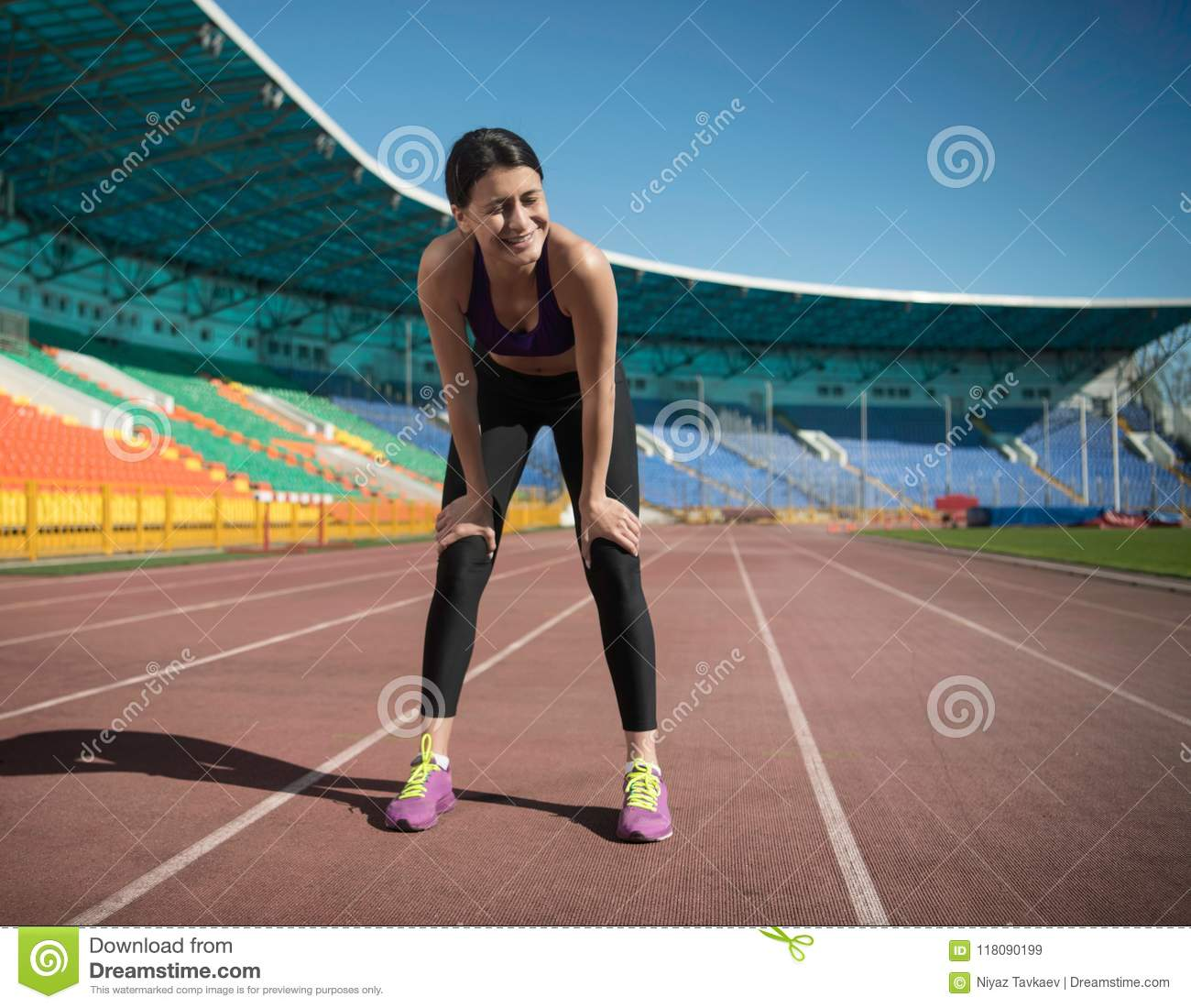 ab5212b010 Track and field woman laughing while having a short break during the  training on the stadium