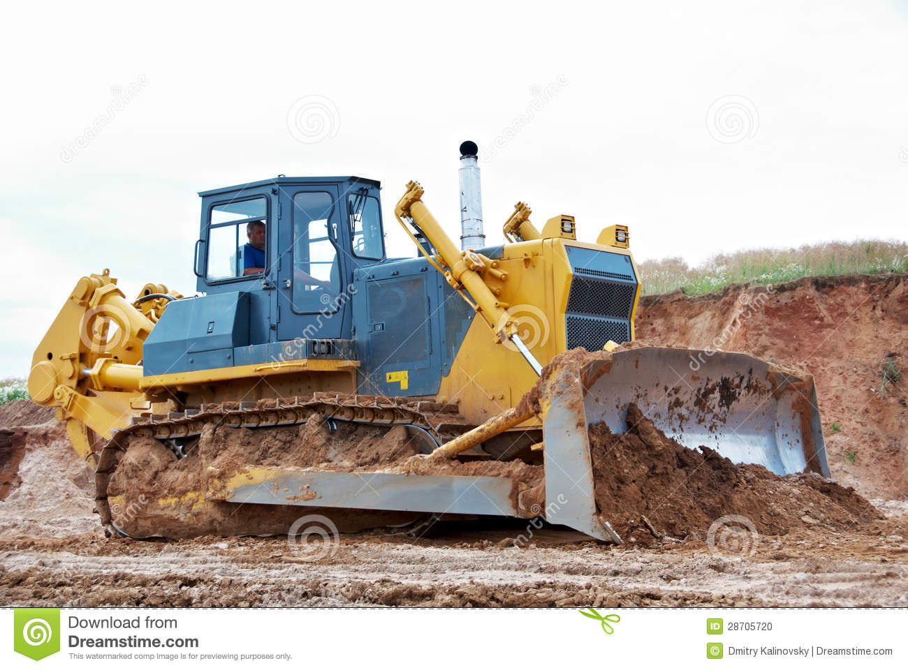 Track-type loader bulldozer excavator at work