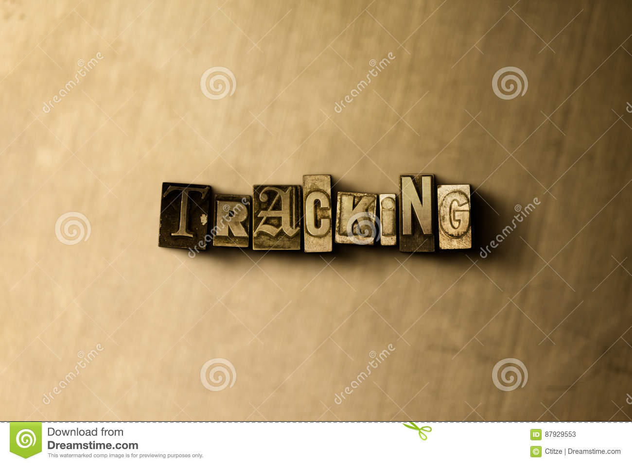 tracking close up of grungy vintage typeset word on metal backdrop