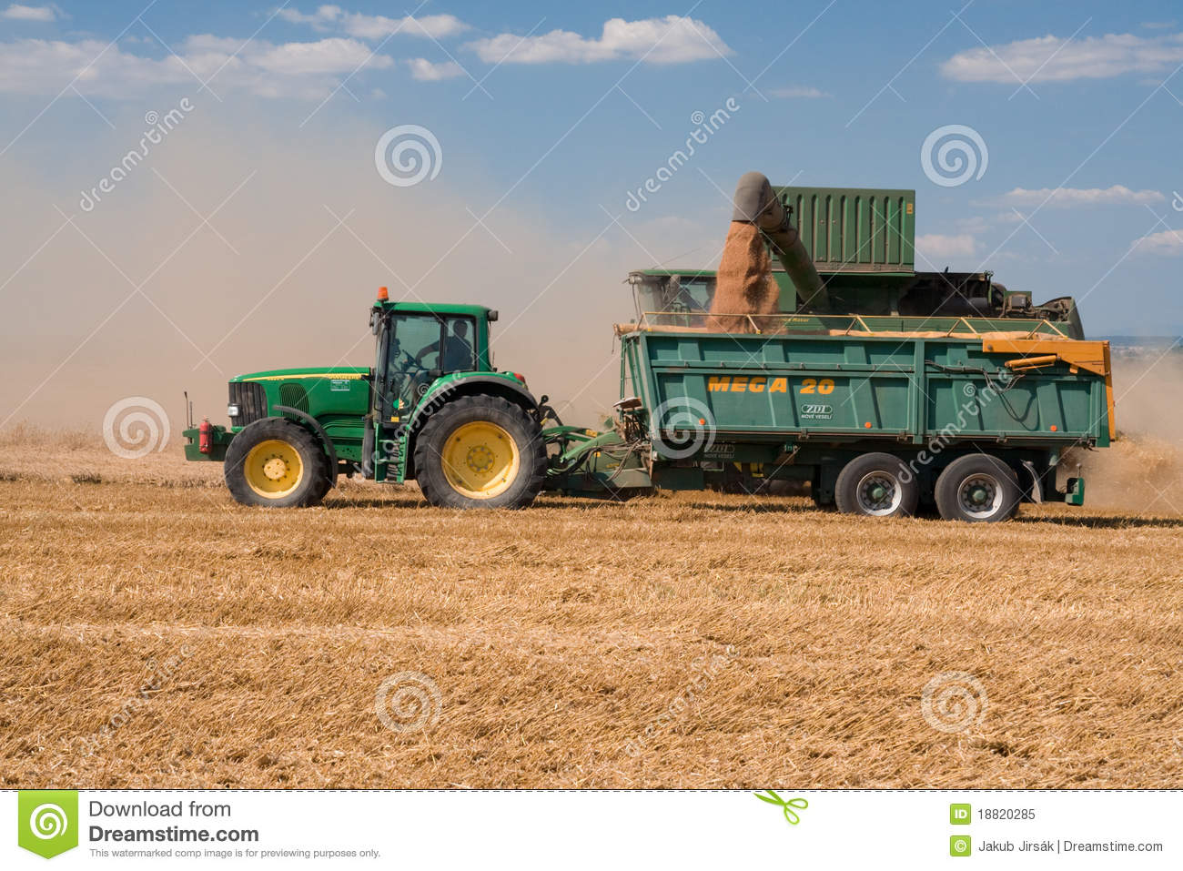 Tractor And Combine John Deere On Harvested Field