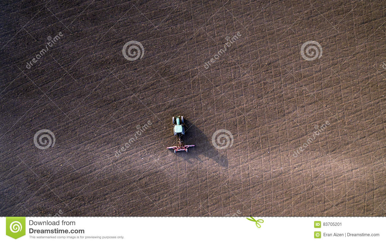 Tractor Cultivating And Harrowing Field Stock Photo