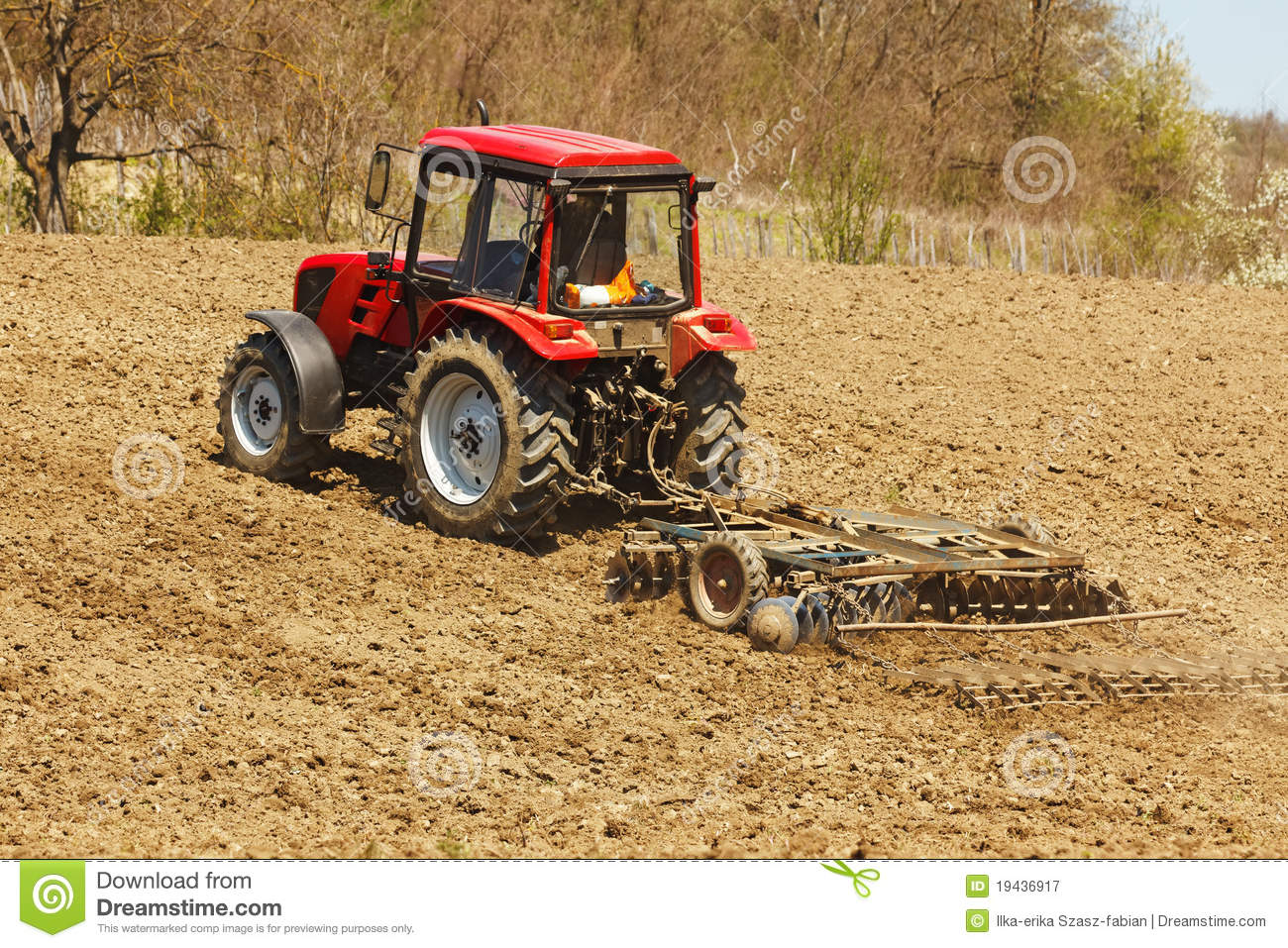 Landscape Rake Or Harrow : Tractor with disk harrow and rake royalty free stock photography