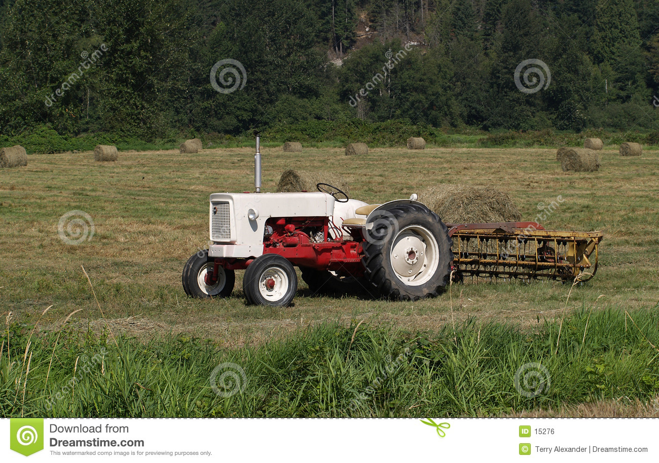 Tractor in hay field