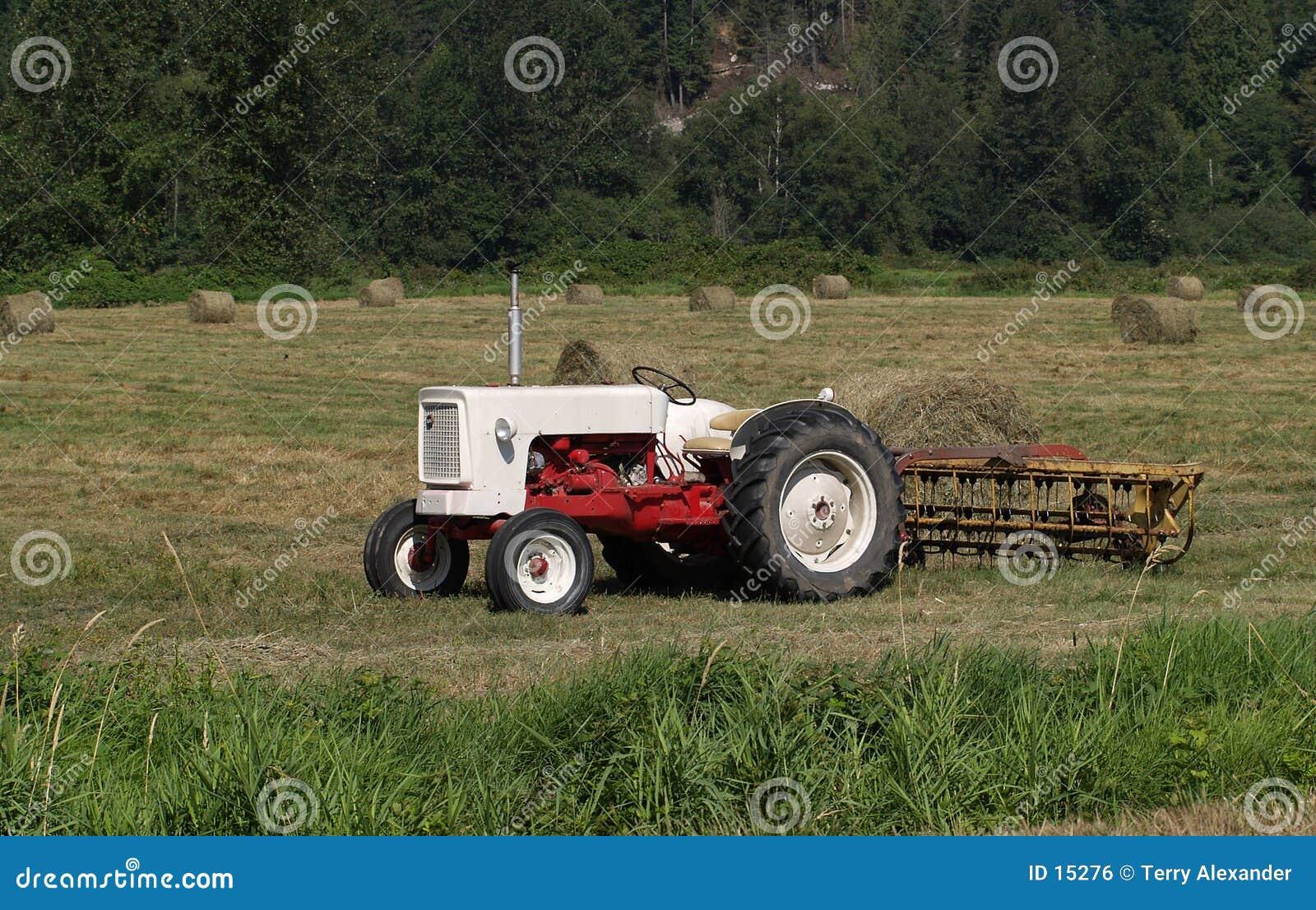 Tractor in hay field