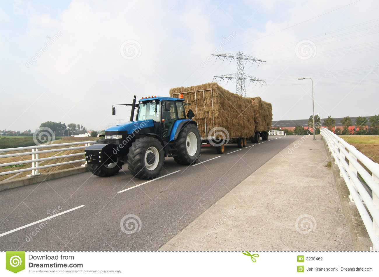 Tractor Pulled Wagon : Tractor with hay wagon stock photography image