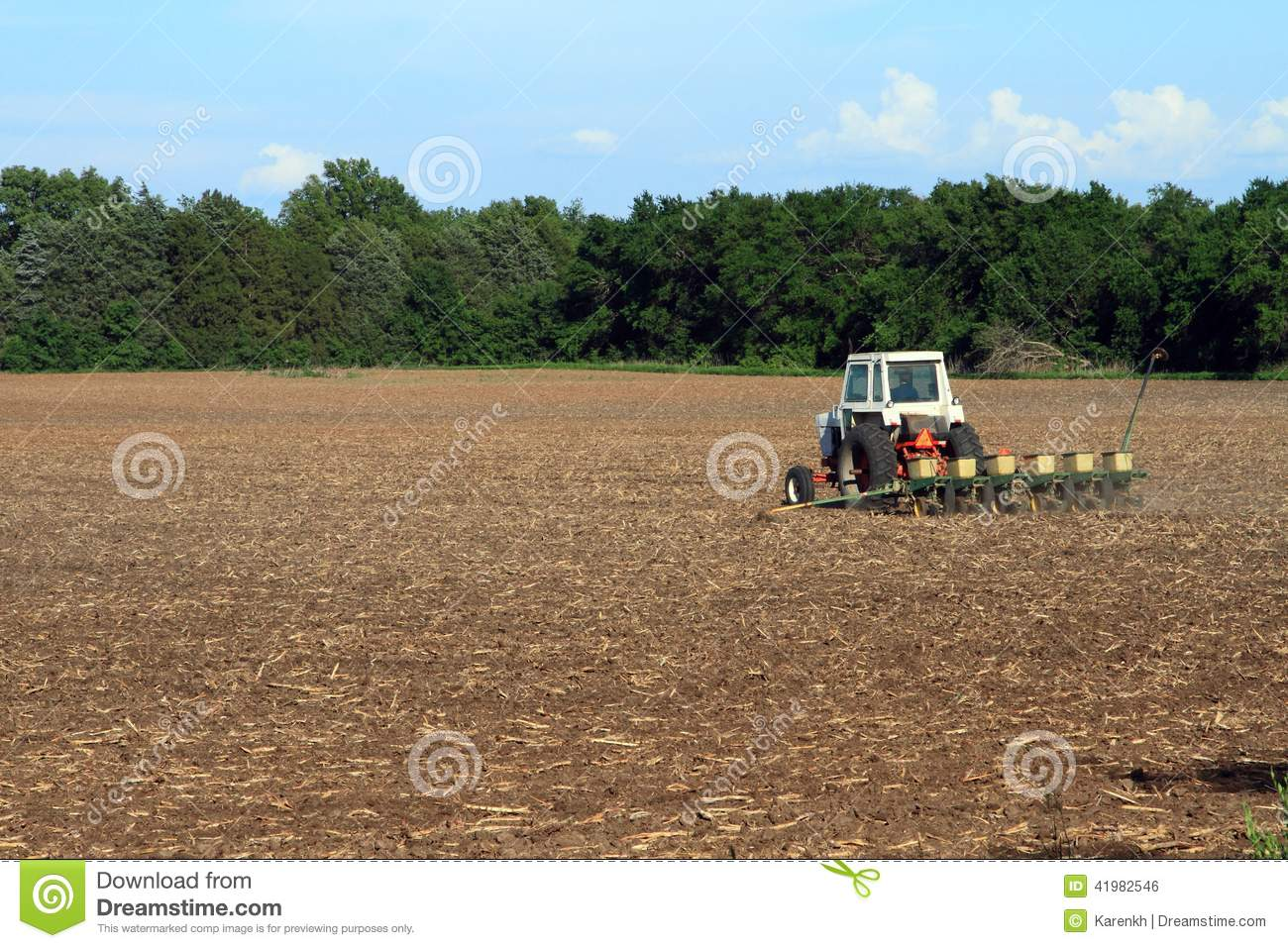 Tractor In Field Planting : Tractor planting the field stock photo image