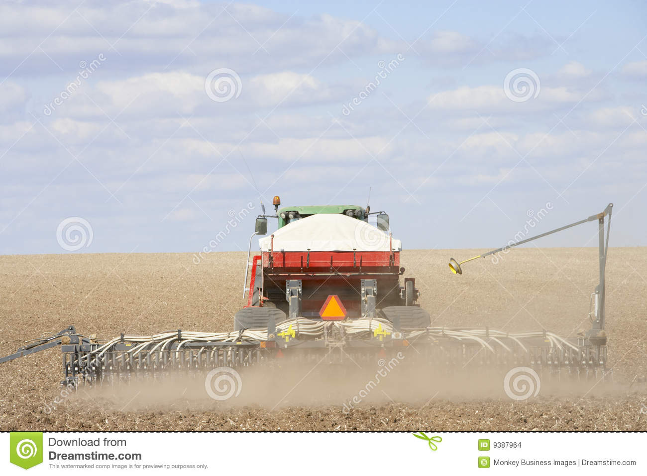Tractor In Field Planting : Tractor planting seed in field stock images image
