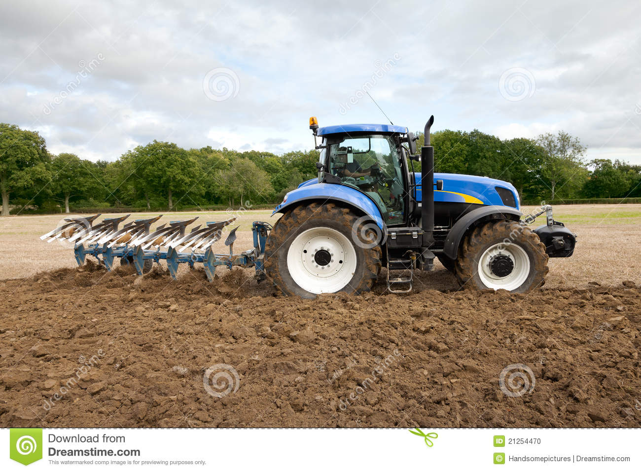 Tractor Ploughing Field Stock Photo - Image: 21254470