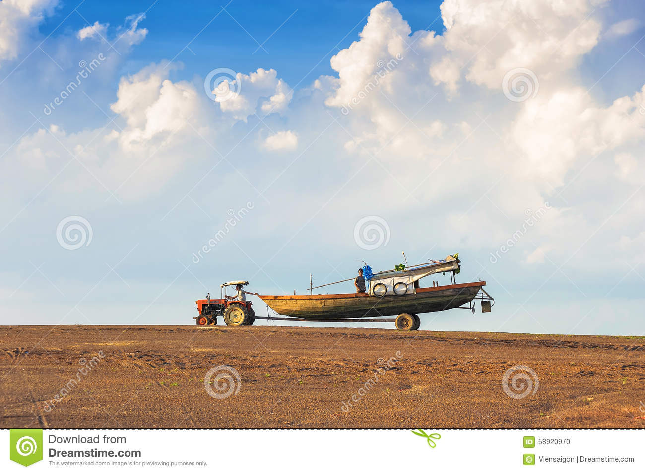 Tractor Pull Boats : Tractor pulling the fishing boat editorial image