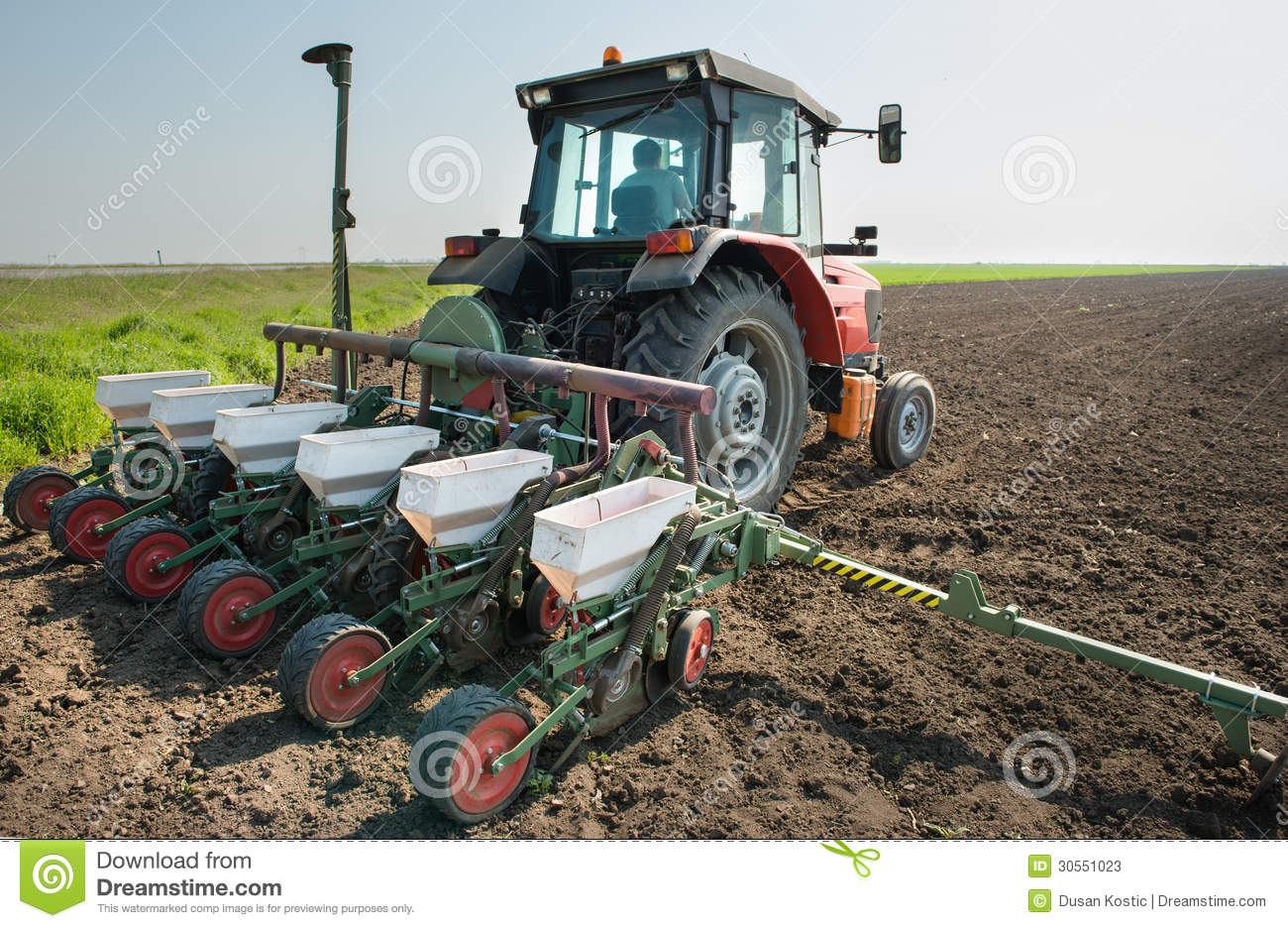 Tractor In Field Planting : Tractor and seeder stock image of industry work