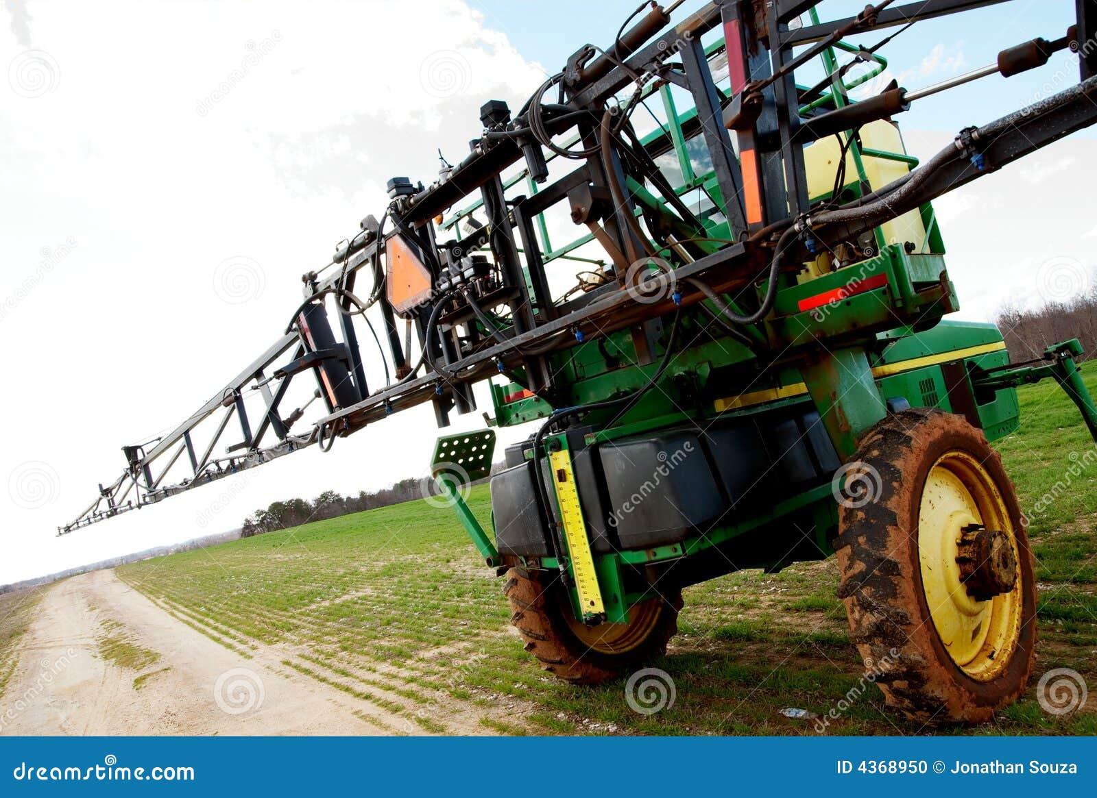 Tractor sprayer on open field 02