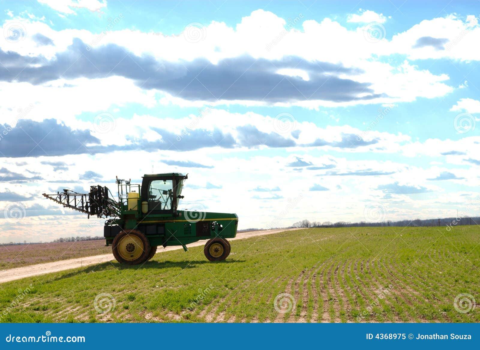 Tractor sprayer on open field 05