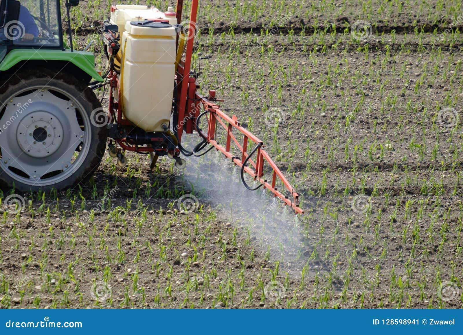 Tractor spraying pesticide