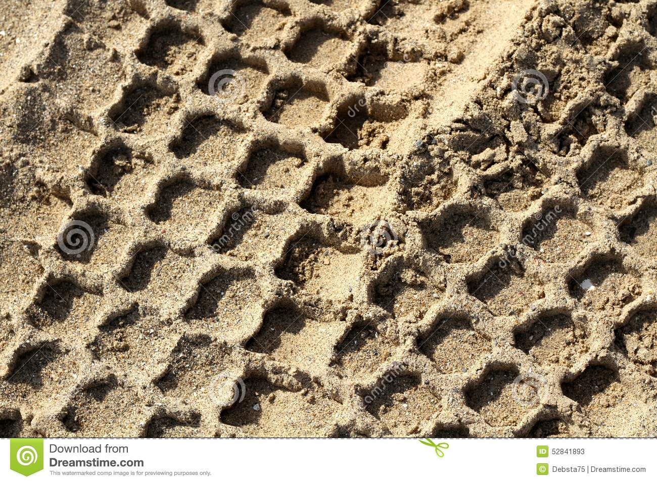 Tractor tracks in sand