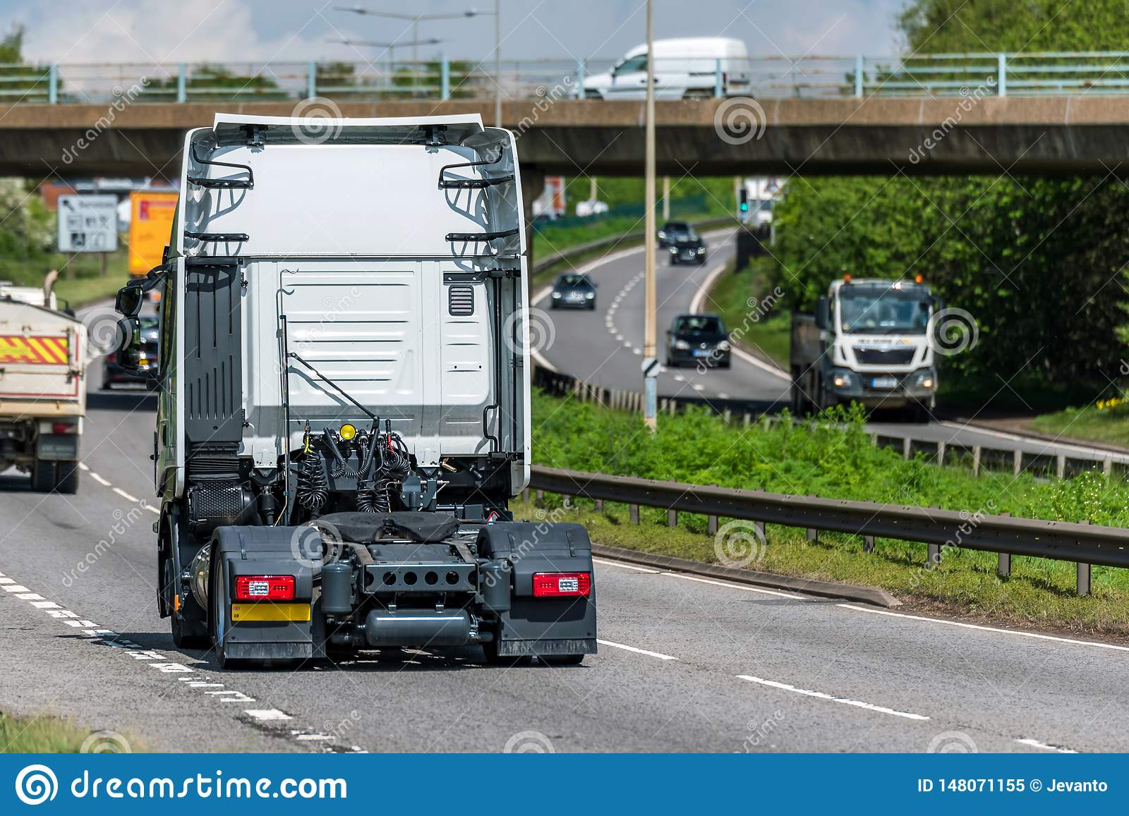 Tractor unit lorry truck on uk motorway in fast motion