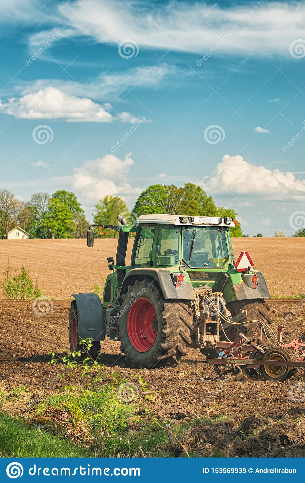 Tractor Working On The Farm, A Modern Agricultural
