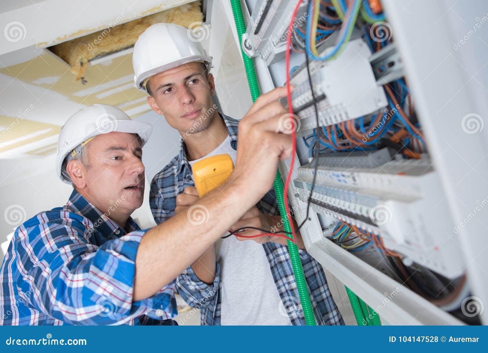 Brilliant Tradesmen Installing Distribution Board Stock Photo Image Of Wiring 101 Israstreekradiomeanderfmnl