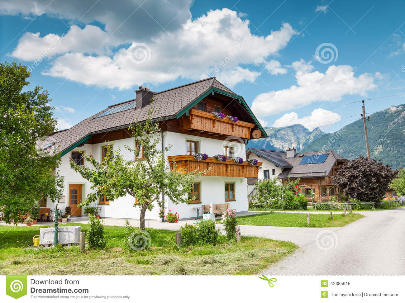 Traditional alpine house in the mountains stock image for Alpine home designs