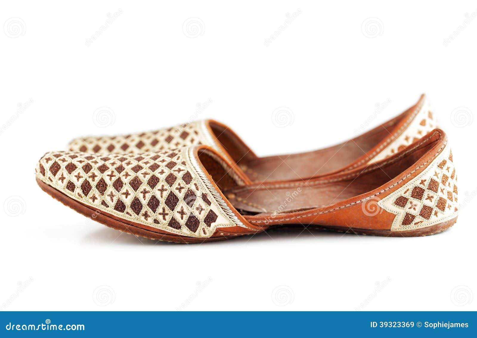 cbb159da0e7 Traditional Arabic slippers shot against a white background
