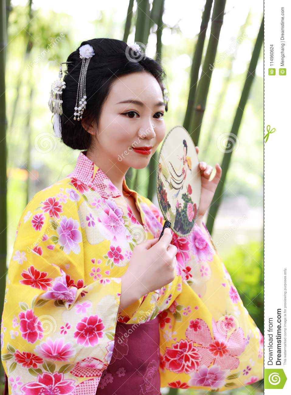 Traditional Asian Japanese Beautiful Geisha Woman Wears Kimono Hold