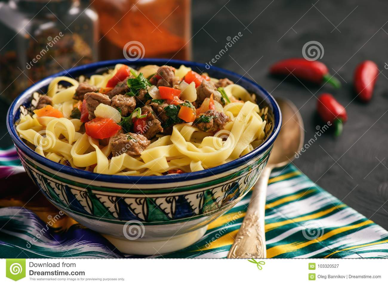 Traditional asian noodle soup with vegetables and meat, known as lagman. Oriental, uzbek style cuisine.