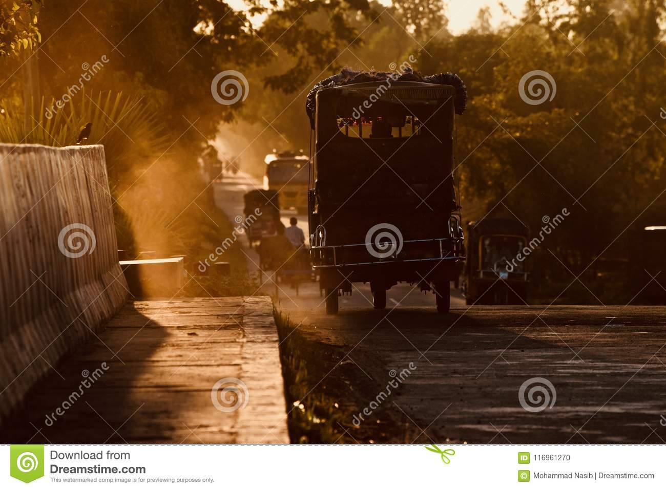 Download Traditional Auto Three Wheeler Is Running On A Road In The Afternoon Stock Photo - Image of auto, creative: 116961270