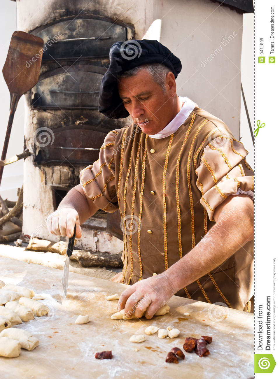 Portrait old a old fashiond baker working at a medieval bakery in ...