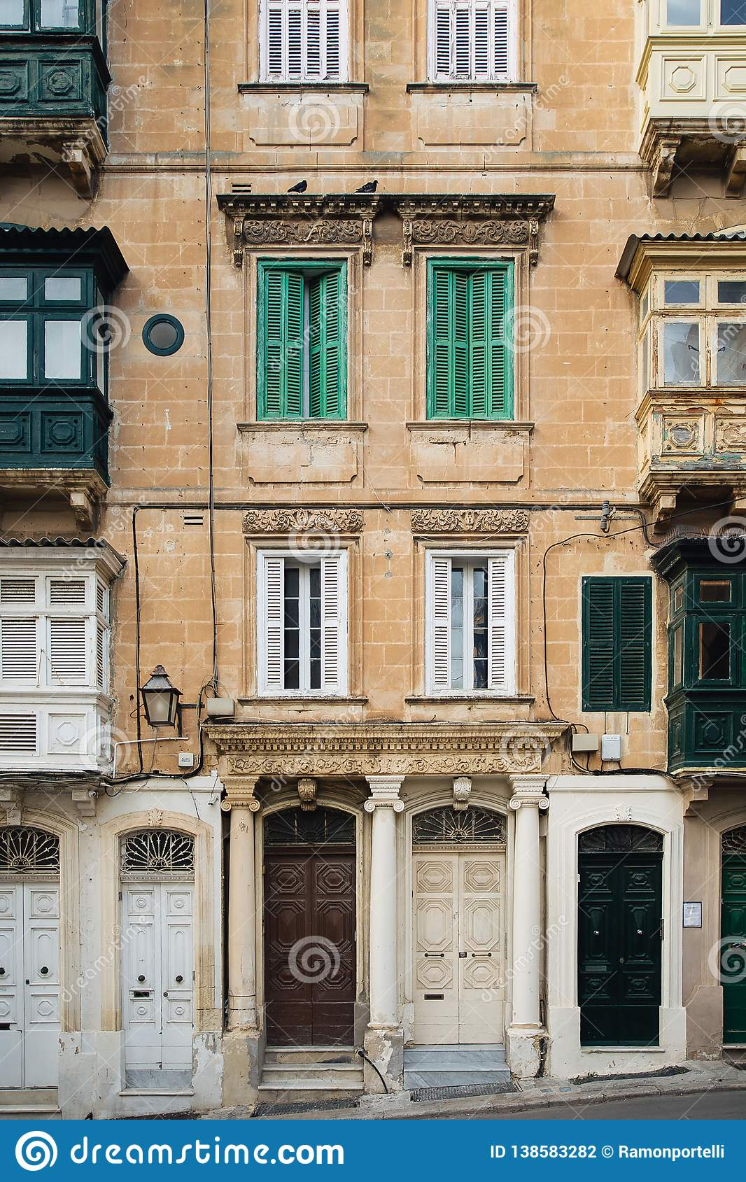 Traditional Balconies, Doors And Windows In A Residential ...