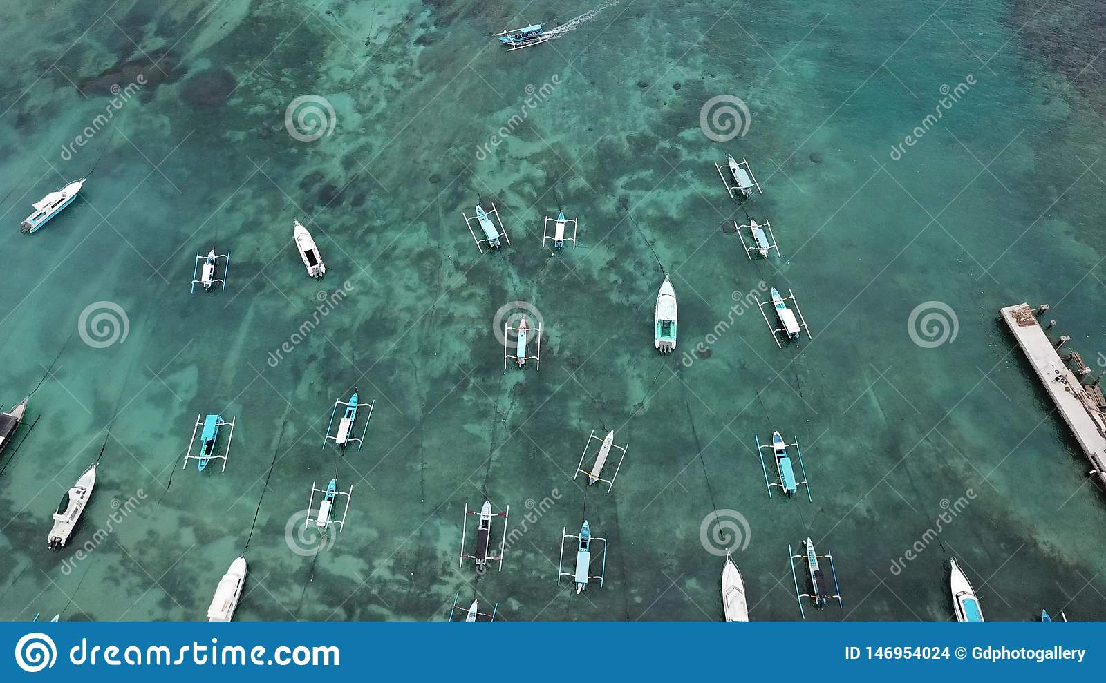 Traditional Balinese Fisher Boats at Sanur Beach, Bali, Indonesia. Drone`s view - Image