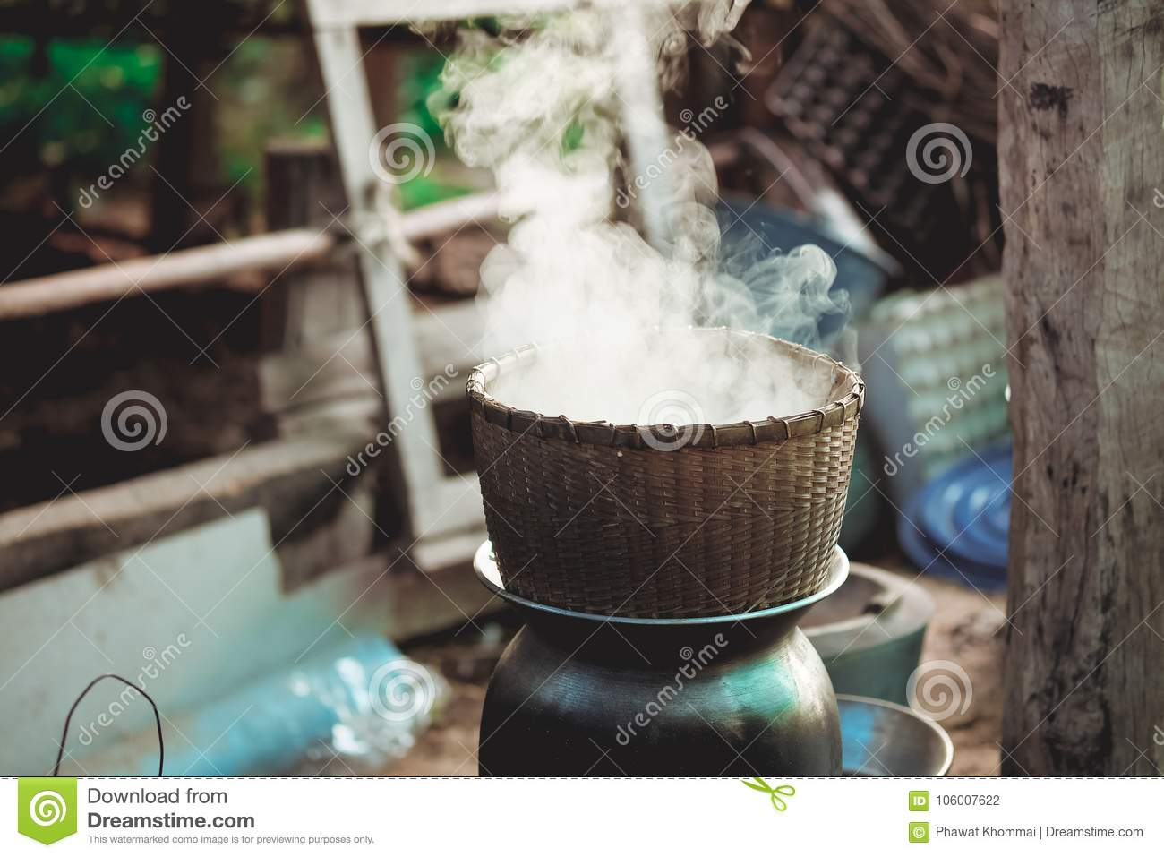 Traditional Bamboo steamer pot to boil water for cooking sticky rice with smoke