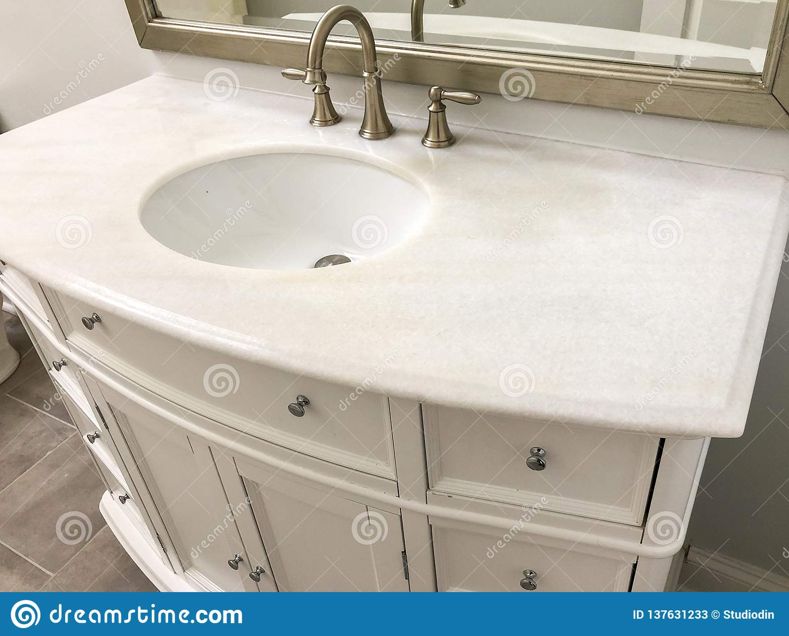 Traditional Bathroom With White Cabinets And Marble Countertop Two Sinks And Faucets With Stone Floor Stock Image Image Of Cabonets Island 137631233