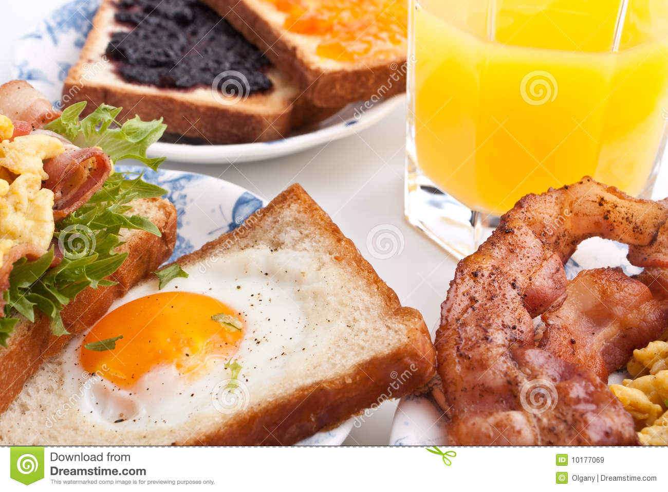 Traditional breakfast with juice, eggs and bacon