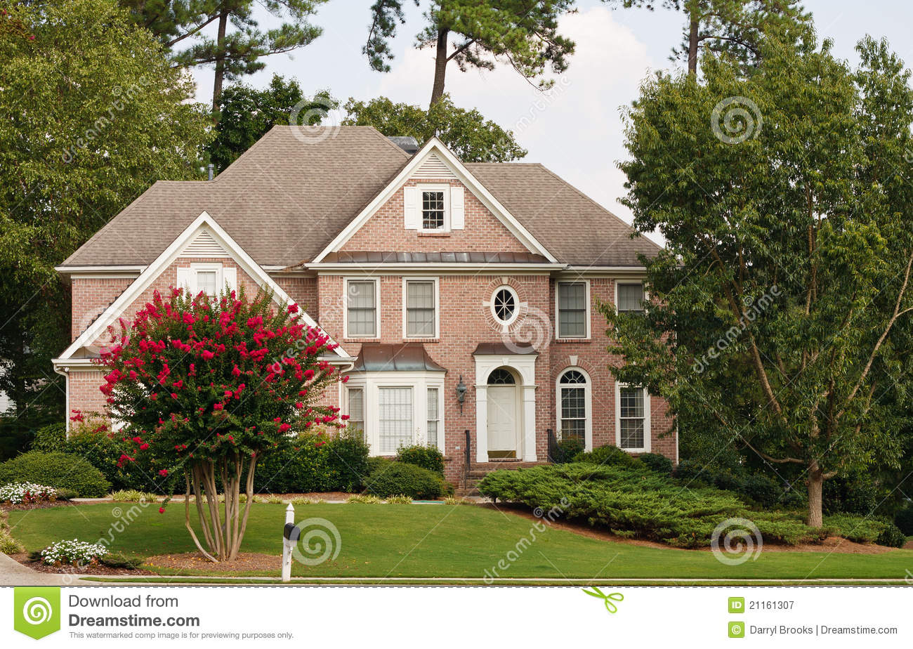 Traditional brick home with blooming crepe myrtle royalty for Traditional brick homes