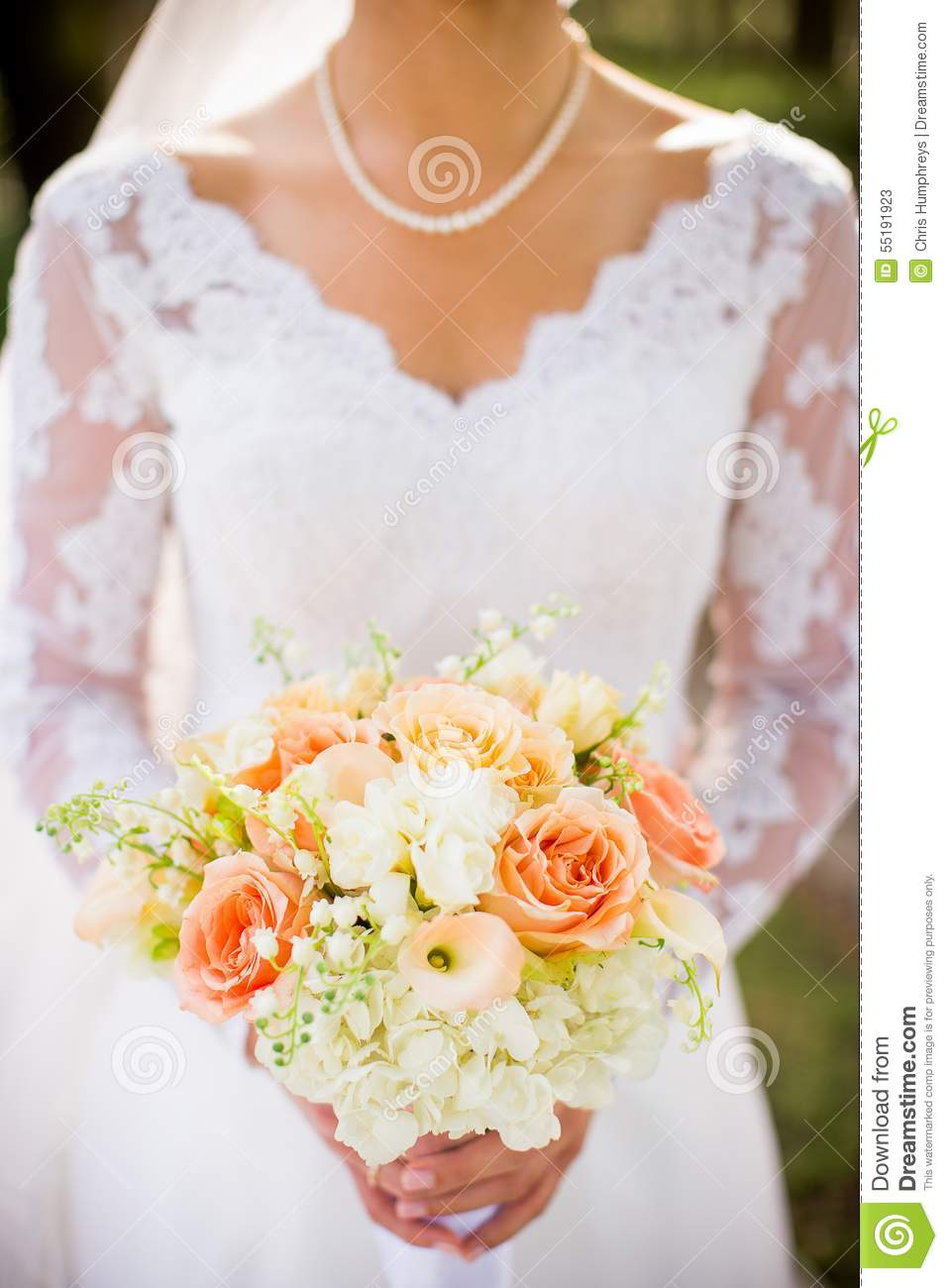Traditional bride with beautiful orange pink and white wedding traditional bride with beautiful orange pink and white wedding bouquet of flowers mightylinksfo