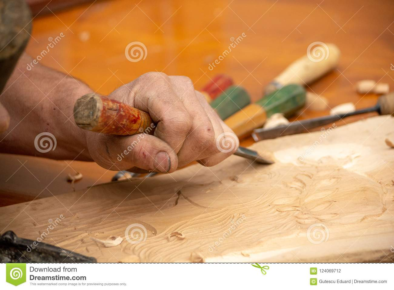 Traditional carpenter close up working hands with carpeting tools.