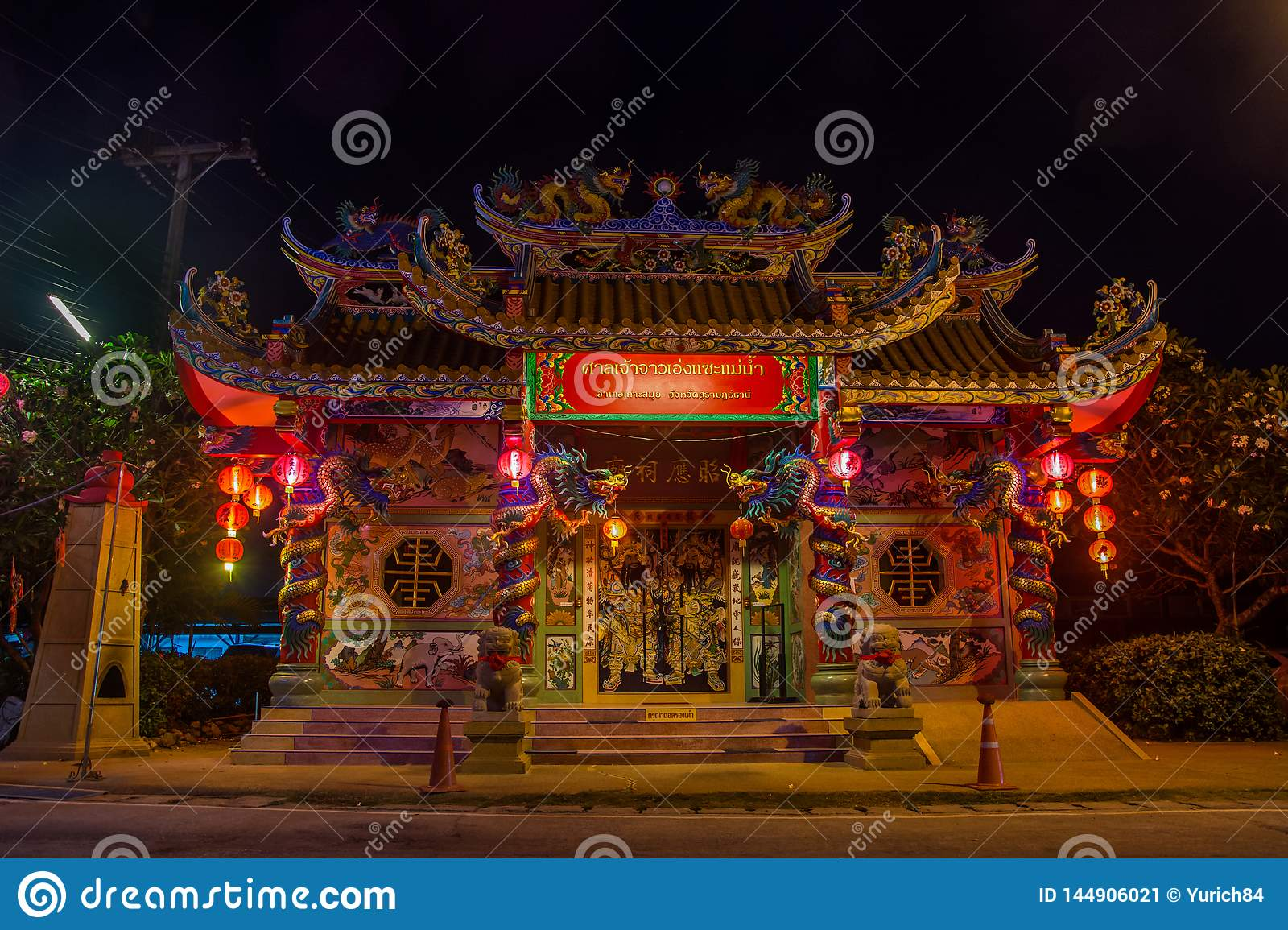 Traditional Chinese Temple With Lights In The Night On Koh