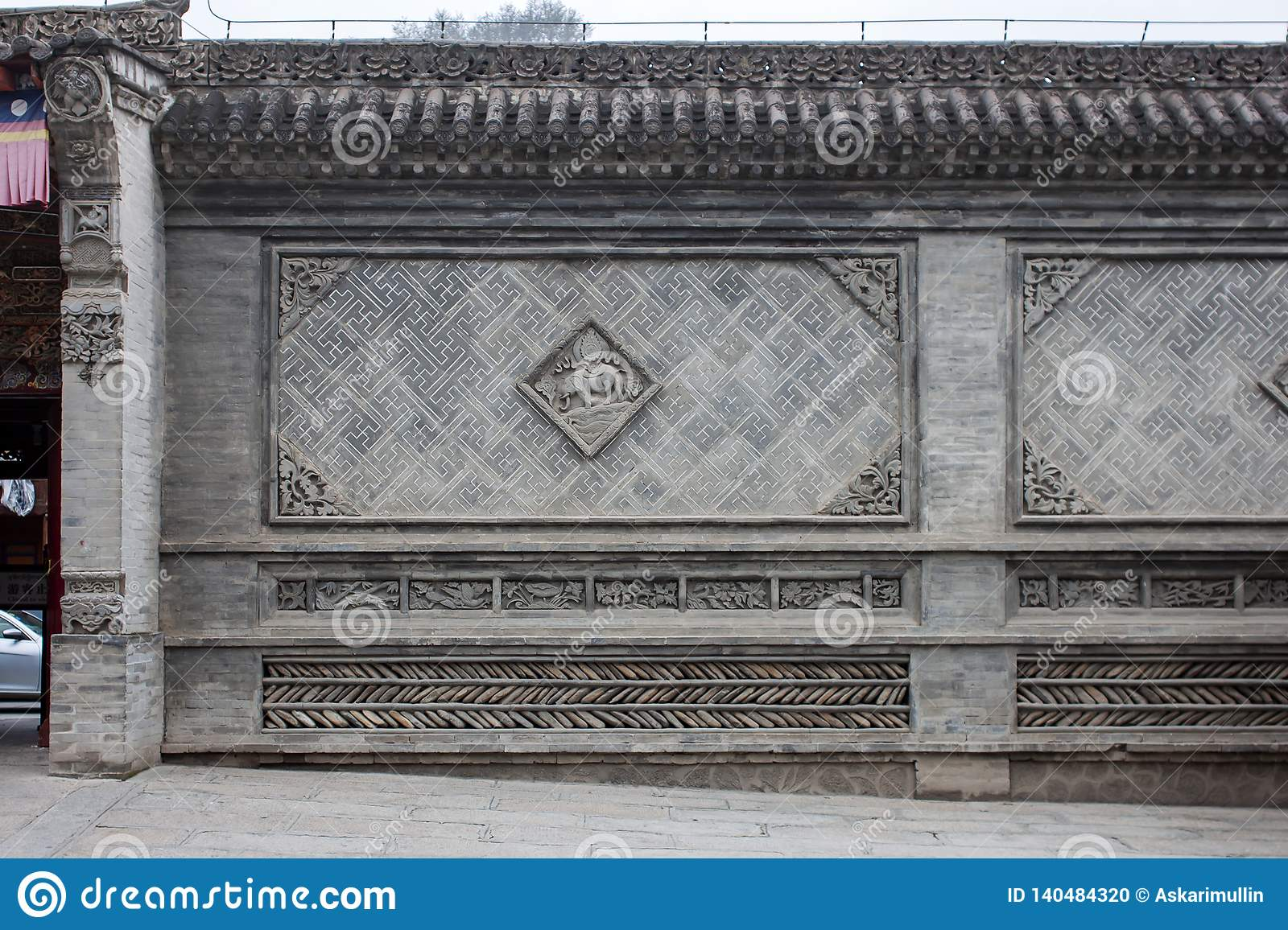Traditional Chinese Wall With Details Of Glazed Green And Grey Tiles
