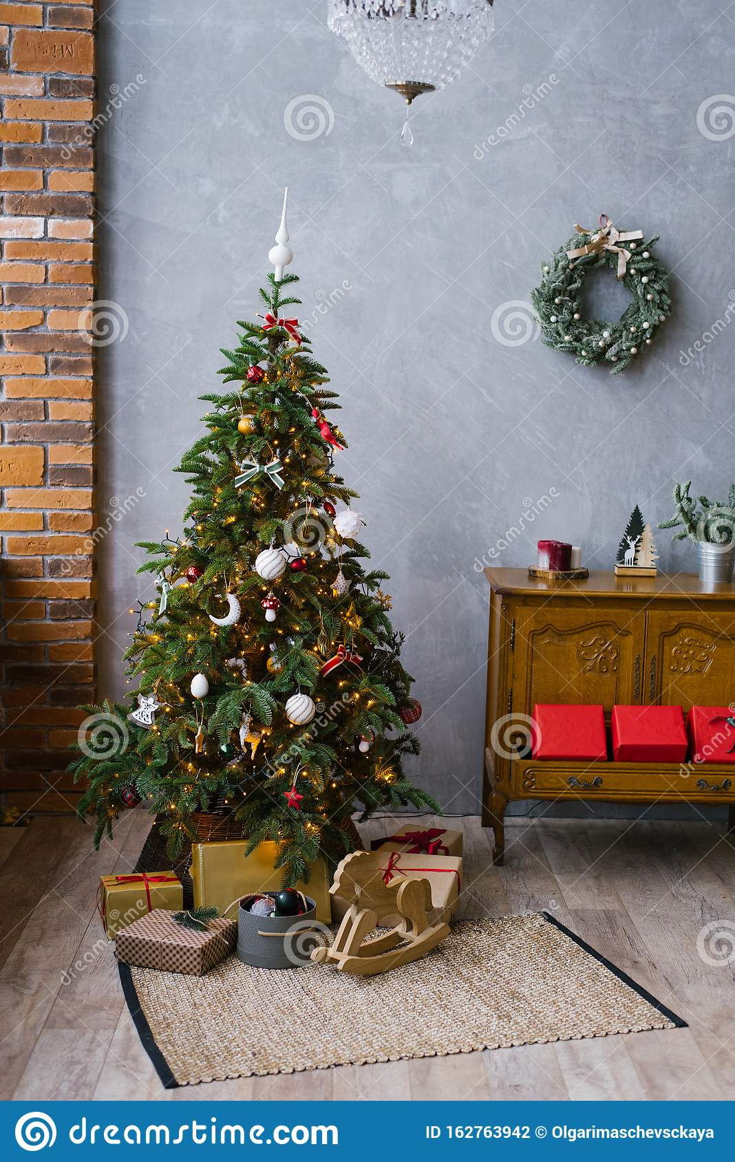 Traditional Christmas Tree With Gifts Under It And A ...