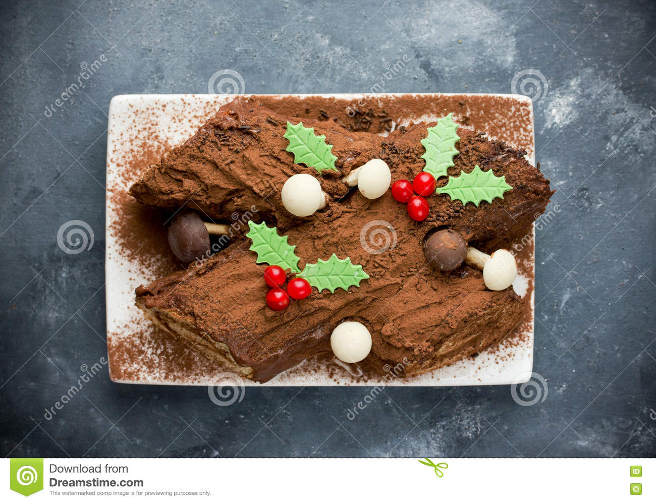 Traditional Christmas Yule Log Cake Decorated With Chocolate Holly