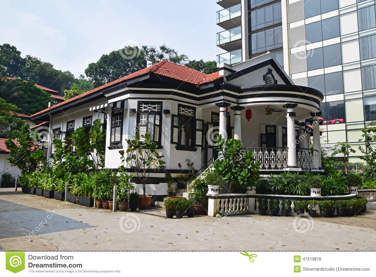 Traditional colonial house singapore next to modern for Traditional house building