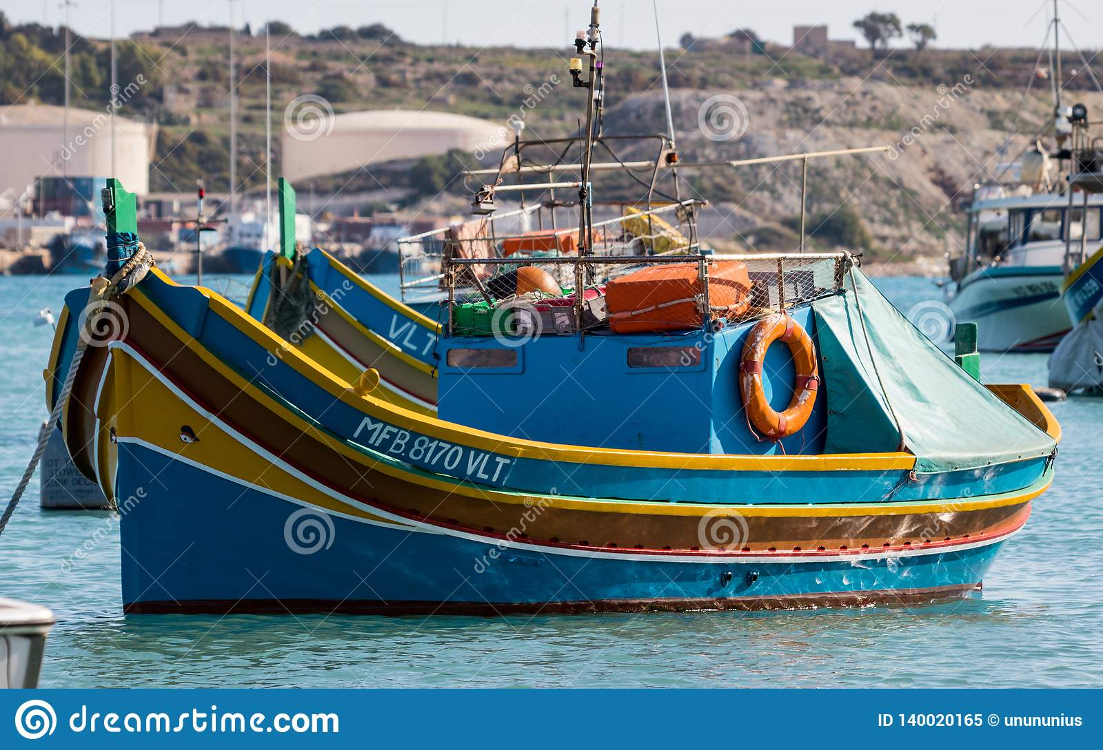 Traditional, colorful Luzzu Boats in the Marsaxlokk Harbour