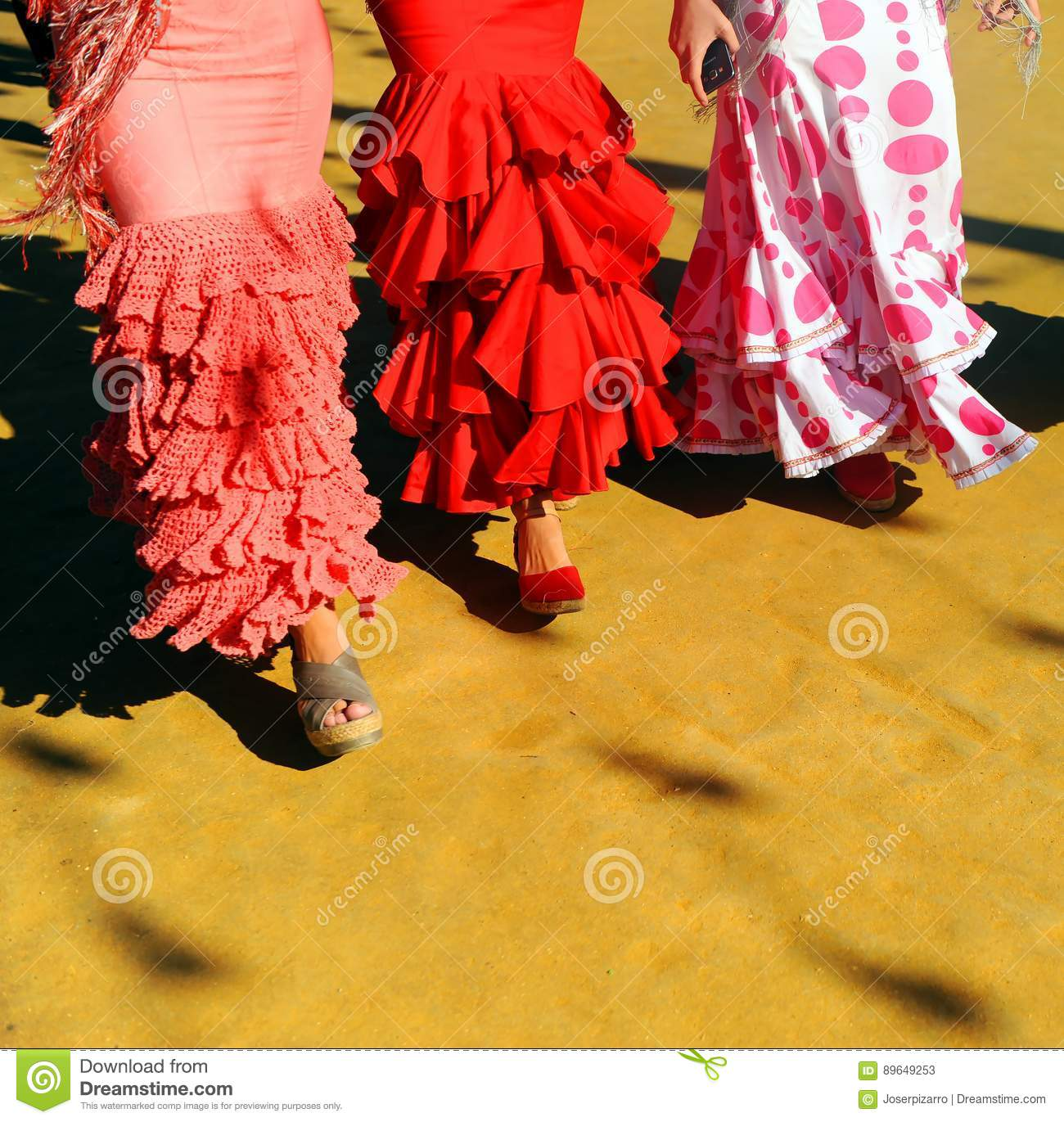 7fc79dfe9cab Andalusian women walking with flamenco dress during the Feria of Sevilla,  Andalusia, Spain