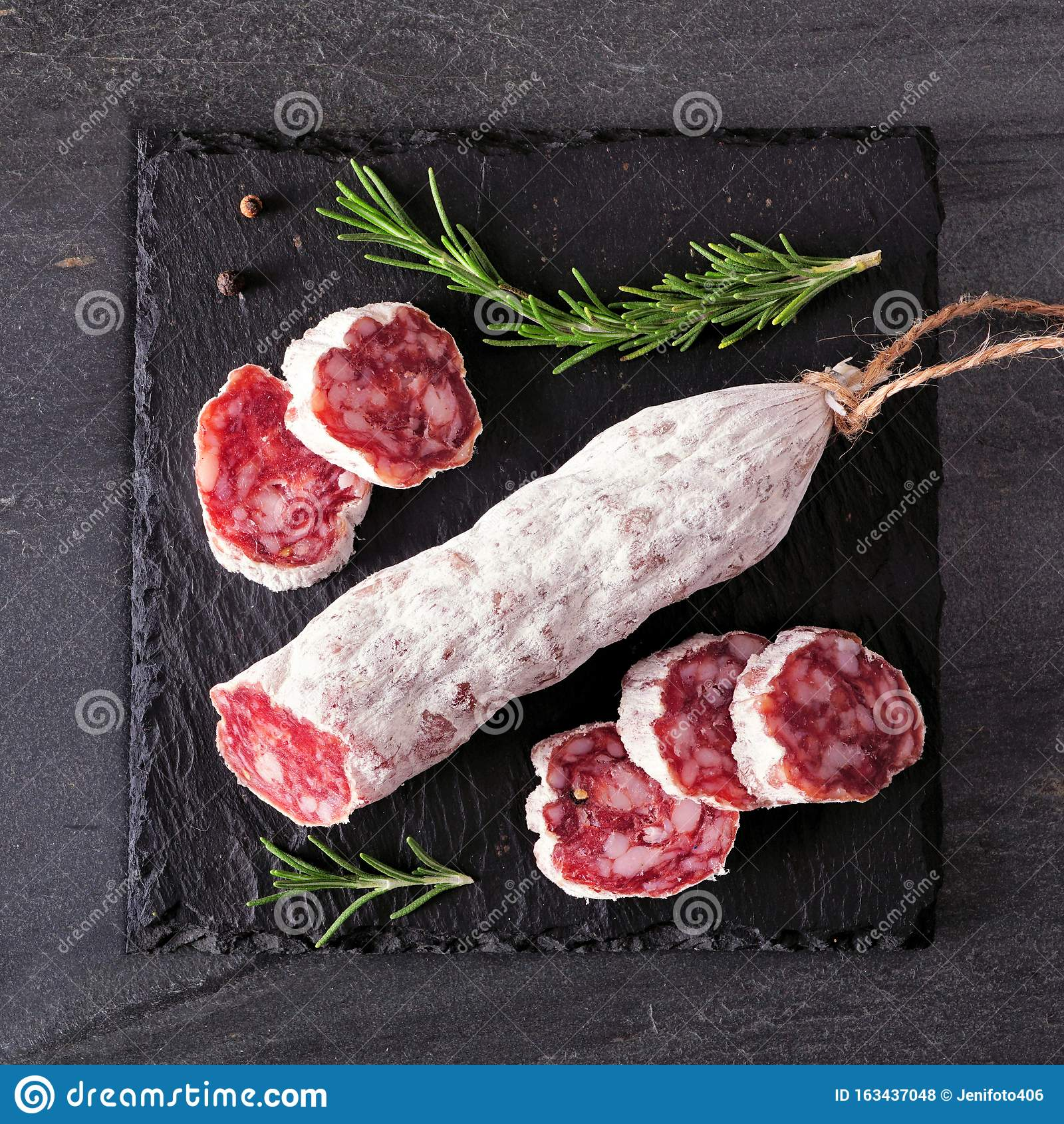 Traditional dry cured sausage, top view on a slate serving board
