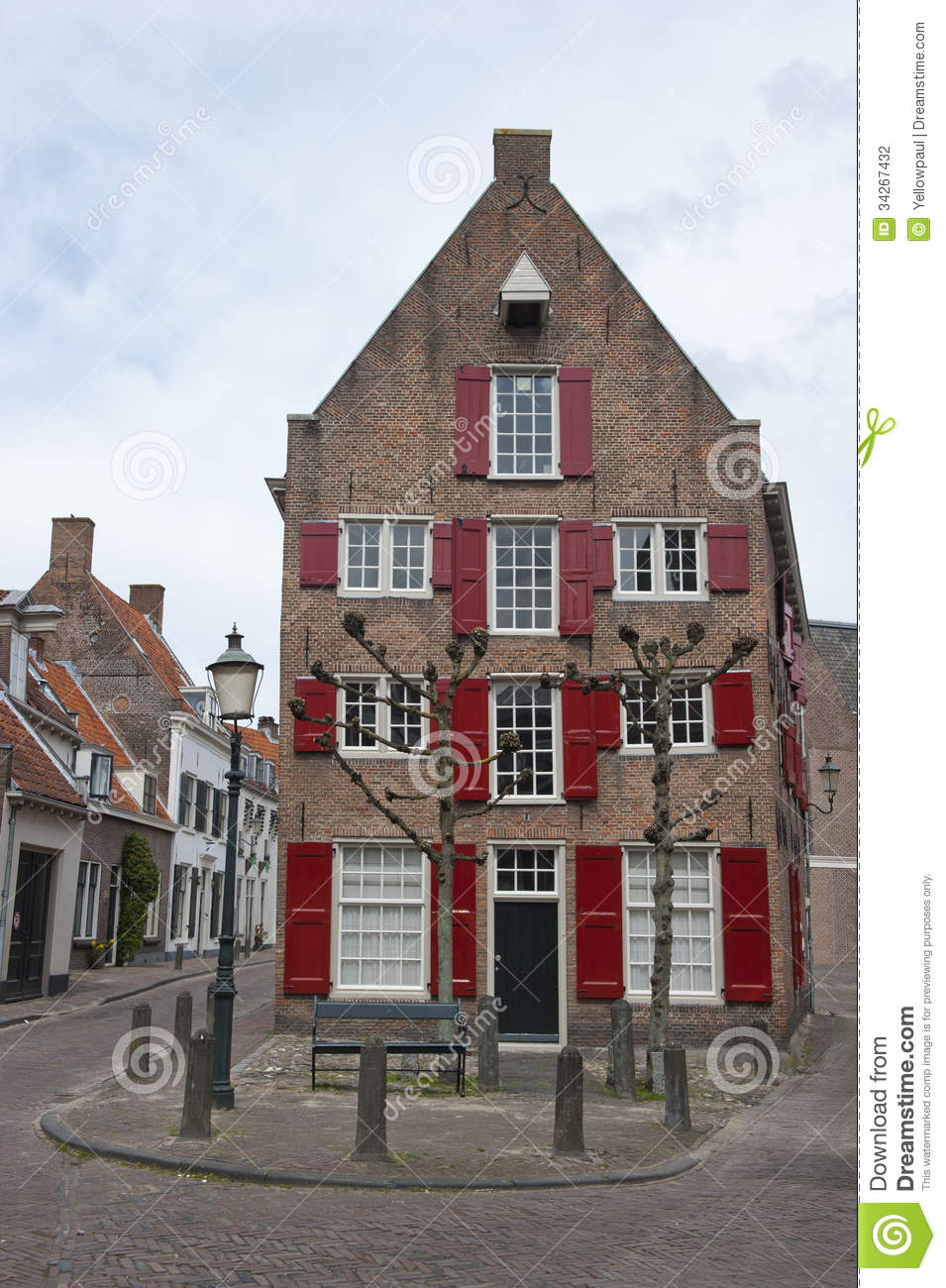 Traditional ducht house with red window shutters stock for Classic dutch house of 60m2