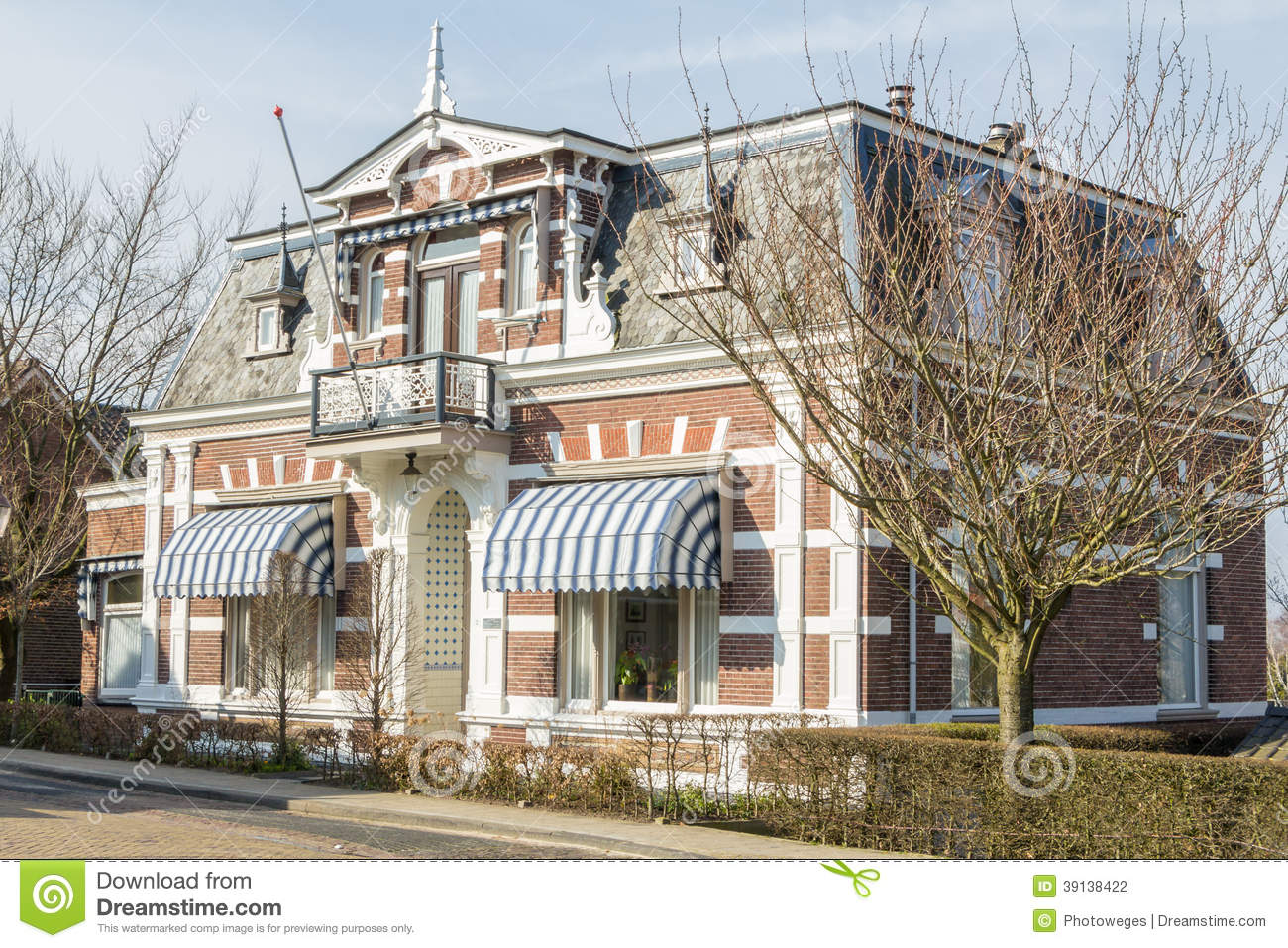 Traditional dutch house in a smal village stock photo for Classic dutch house of 60m2