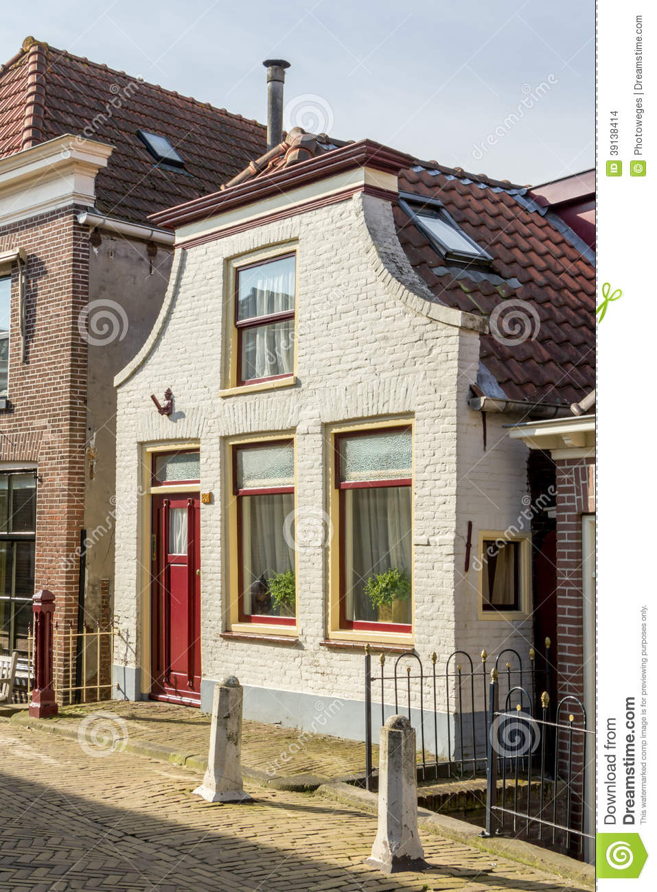 Traditional dutch house in a small village stock photo for Classic dutch house of 60m2