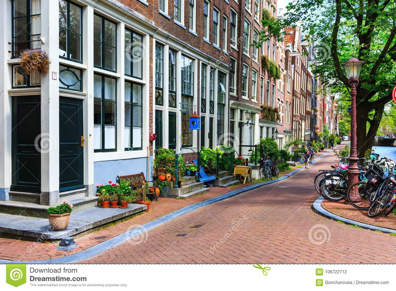 Traditional dutch houses, bicycles parked on city street at summer. Typical holland architecture. Exterior. Amsterdam, Netherlands