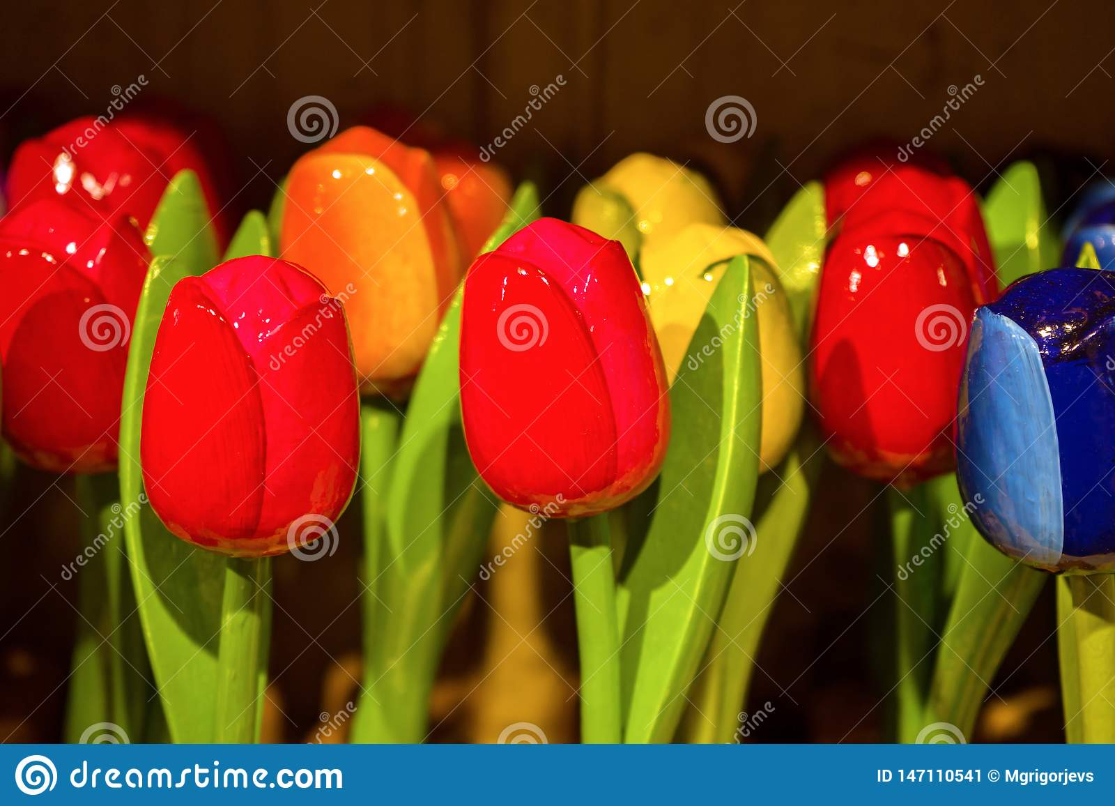 Traditional Dutch Wooden painted colorful tulips in souvenir shop