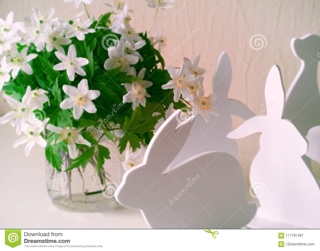 Easter bunnies with spring flowers