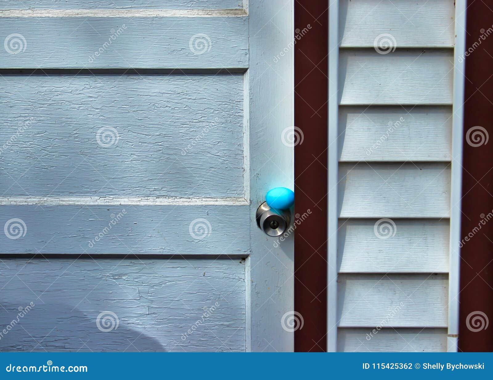 Delicieux Download Traditional Easter Egg Hunt In Backyard. Blue Egg Is Hidden On  Doorknob Of Weathered